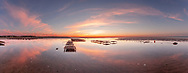 A colorful sunset and its reflection at Mant's Landing in Brewster