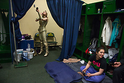 """Tatiana Tchalabaev, of The Thundering Cossack Warriors, prepares backstage. <br /> Ringling Bros. and Barnum & Bailey Circus started in 1919 when the circus created by James Anthony Bailey and P. T. Barnum merged with the Ringling Brothers Circus. Currently, the circus maintains two circus train-based shows, the Blue Tour and the Red Tour, as well as the truck-based Gold Tour. Each train is a mile long with roughly 60 cars: 40 passenger cars and 20 freight. Each train presents a different """"edition"""" of the show, using a numbering scheme that dates back to circus origins in 1871 — the first year of P.T. Barnum's show."""
