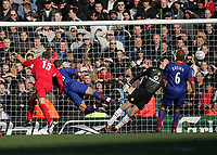 Photo: Lee Earle.<br /> Liverpool v Manchester United. The FA Cup. 18/02/2006. Liverpool's Peter Crouch (L) heads the winning ball, as United keeper Edwin van der Sar gets is hand to it but fails to keep it out.