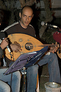 Playing the Ud (Lute)