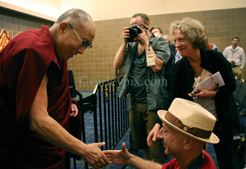17 May 2013. New Orleans, Louisiana,  USA..Advocate photographer John McCusker photographs His Holiness the 14th Dalai Lama at the press conference preceeding the 'Resiliance - Strength through Compassion and Connection' conference. .Photo; Charlie Varley.