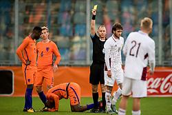 (L-R) referee Dennis Antamo, Ivanovs Nikita of Jong Letland during the EURO U21 2017 qualifying match between Netherlands U21 and Latvia U21 at the Vijverberg stadium on October 06, 2017 in Doetinchem, The Netherlands
