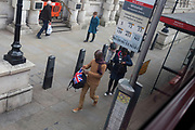 Aerial view of Londoners at a bus stop on Whitehall in Westminster, on 26th March 2019, in London, England