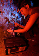 """Geologist Kira Westaway from the University of Wollongong samples sediment for use in thermoluminescence dating, one of six techniques used to develop a timeline for Liang Bua Cave, discovery site of the Flores """"hobbit, Homo floresiensis"""