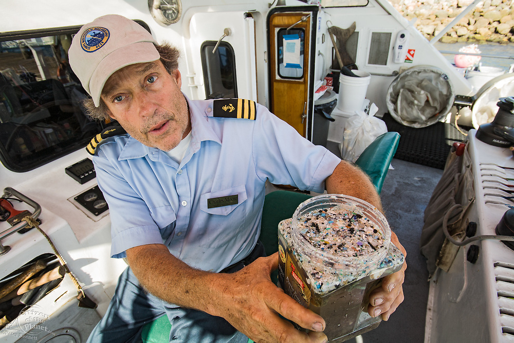 """Captain Charles Moore, the man credited for first discovering the plastic soup in the Gyre over 10 years ago, showing plastic samples collected in the North Pacific Gyre.  The ORV Alguita returns to Long beach after four months at sea sampling the waters of the """"great Pacific garbage patch"""" in the North Pacific Subtropical  Gyre (NPSG). The Algalita Marine Research Foundation has been studying and educating the public about the effects of oceanic micro-plastic pollution on the ocean's ecosystem and marine life for over ten years. Long Beach, California, USA."""