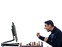 caucasian man playing chess victorious against computer concept on isolated white background