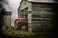 An aged pickup truck sits in a well weathered shed in a rural part of southern New Jersey.