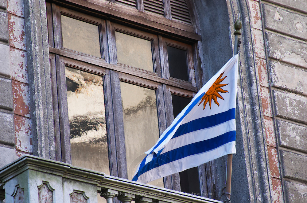 The Uruguay flag outside a window on a balcony in the Old Town Ciudad Vieja. Montevideo, Uruguay, South America