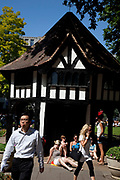 Office workers gather yto relax in the sunshine at lunchtime in Soho Square (also known as Soho Beach) in central London. Home of London's gay community.