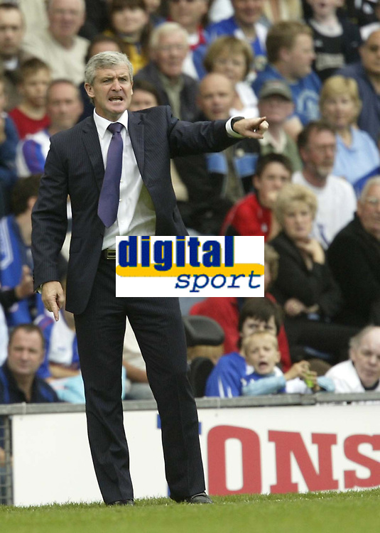 Photo: Aidan Ellis.<br /> Blackburn Rovers v Manchester City. The Barclays Premiership. 17/09/2006.<br /> Blackburn boss Mark Hughes dishes out instructions
