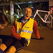 Triathlete Paul Parrish reacts to a massage during a break in the cycle section of his Arch to Arch triathlon attempt in northern France September 17, 2014.