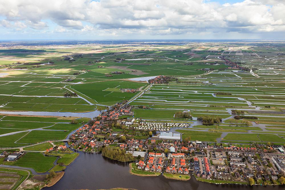 Nederland, Noord-Holland, Graft-De Rijp, 16-04-2012; De Rijp (rechtsonder), Graft (midden naar boven). Zicht op de verkaveling van de Eilandspolder (rechts), de Schermer (links). Duinen en Noordzee in de zon aan de horizon. .View on the old town of De Rijp with church  in the polder Beemster. Land division of the Eilandspolder (meadows). At the horizon the Northsea with dunes..luchtfoto (toeslag), aerial photo (additional fee required).foto/photo Siebe Swart