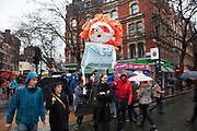London, UK. Saturday 13th April 2013. A puppet representation of Margaret Thatcher is paraded along Charing Cross Road to the Margaret Thatcher Death Party in Trafalgar Square, to celebrate the late Prime Minister's passing away.