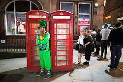 © Licensed to London News Pictures . 26/12/2016 . Wigan , UK . Revellers in Wigan enjoy Boxing Day drinks and clubbing in Wigan Wallgate . In recent years a tradition has been established in which people go out wearing fancy-dress costumes on Boxing Day night . Photo credit : Joel Goodman/LNP