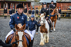 Horses are paraded during the first ever memorial service dedicated to horses killed or injured in conflict, at the Royal Navy and Royal Marines Riding Stables at Bickleigh Barracks, Plymouth.
