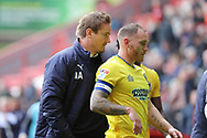 AFC Wimbledon manager Neal Ardley walking off pitch with AFC Wimbledon defender Barry Fuller (2) during the EFL Sky Bet League 1 match between Charlton Athletic and AFC Wimbledon at The Valley, London, England on 28 October 2017. Photo by Matthew Redman.