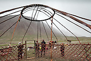 Setting up the center piece of the yurt of the Khan, the tribal leader, during yearly summer migration. Afghan Kyrgyz are semi-nomadic people...Trekking through the high altitude plateau of the Little Pamir mountains (average 4200 meters) , where the Afghan Kyrgyz community live all year, on the borders of China, Tajikistan and Pakistan.