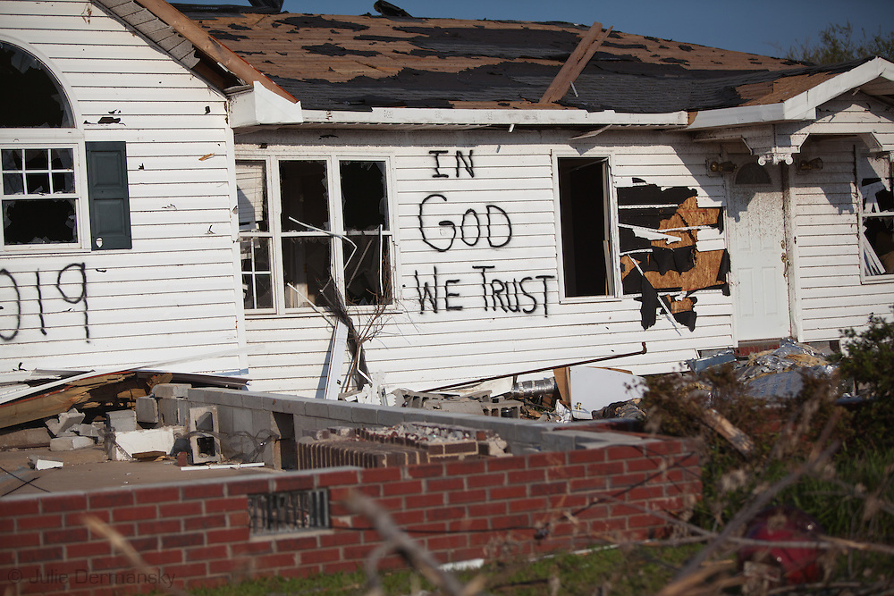 House with a religious message painted on it after being destroyed by a tornado in Holt, Alabama. Holt, a suburb of Tuscaloosa remains in a state of ruin over two weeks after it was hit by an F-4 ( possibly an F-5) tornado, one of an estimated 300 that struck Alabama and the neighboring states on April 27th , 2011.