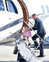 The Duke of Cambridge boards a plane in Hamburg with Princess Charlotte at the end of the visit to Germany with his wife the Duchess of Cambridge and Prince George.