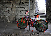 © licensed to London News Pictures. New York, USA  2805/11.  A 'knitted bycicle' under Brooklyn Bridge. Photo credit should read Stephen Simpson/LNP