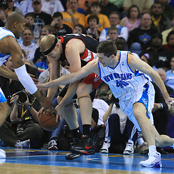 06 February 2009:  Toronto Raptors center Jake Voskuhl (77) fights with Hornets defenders Ryan Bowen (40) and David West (30) over a loose ball during a NBA game between the New Orleans Hornets and the Toronto Raptors at the New Orleans Arena in New Orleans, LA.