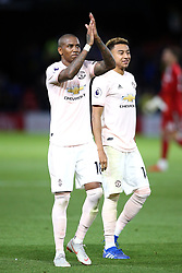 Manchester United's Ashley Young (left) applauds the fans after the final whistle during the Premier League match at Vicarage Road, Watford