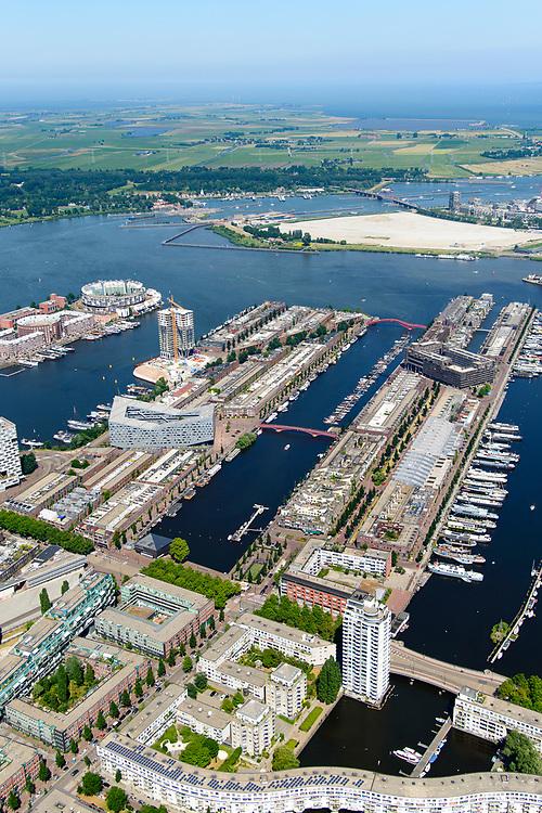 Nederland, Noord-Holland, Amsterdam, 29-06-2018; Zeeburg, Rietlandpark, voormalige Stadsrietlanden. KNSM eiland met Verbindingsdam (links), Sporenburg, Borneo-eiland, Borneolaan en Borneosteiger. Ertshaven, Entrepothaven.<br /> Former eastern port area, now residential area.<br /> <br /> luchtfoto (toeslag op standard tarieven);<br /> aerial photo (additional fee required);<br /> copyright foto/photo Siebe Swart
