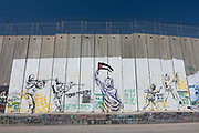 Political artwork along the partition wall which annexes Palestinian land to Israel on 1st April 2016 in Bethlehem, West Bank. During the Palestine Marathon, thousands of runners, both professional and amateur come from across the globe to take part in the Right to Movement event.