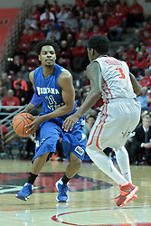 26 February 2014:  Devonte Brown is held at the three point arc by Daishon Knight during an NCAA Missouri Valley Conference (MVC) mens basketball game between the Indiana State Sycamores and the Illinois State Redbirds  in Redbird Arena, Normal IL.