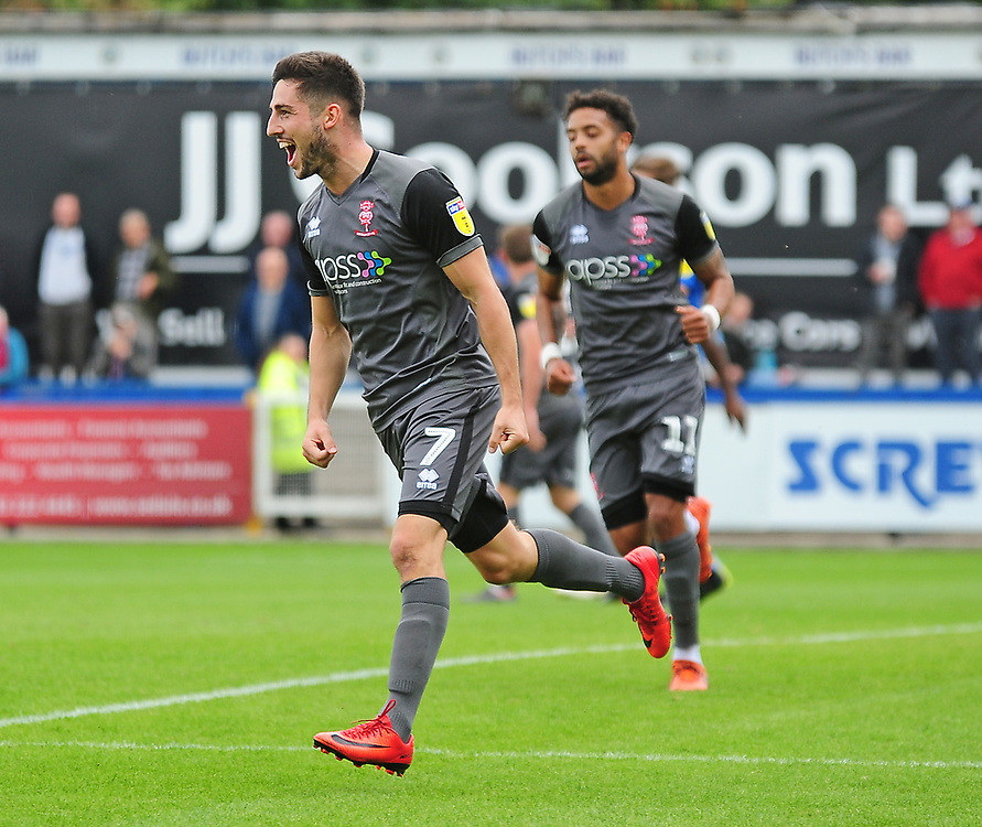 Lincoln City's Tom Pett celebrates scoring the opening goal<br /> <br /> Photographer Andrew Vaughan/CameraSport<br /> <br /> The EFL Sky Bet League One - Macclesfield Town v Lincoln City - Saturday 15th September 2018 - Moss Rose - Macclesfield<br /> <br /> World Copyright © 2018 CameraSport. All rights reserved. 43 Linden Ave. Countesthorpe. Leicester. England. LE8 5PG - Tel: +44 (0) 116 277 4147 - admin@camerasport.com - www.camerasport.com