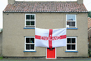 England flag hanging outside a house to celebrate the 2018 World Cup in the village of Topcliffe, North Yorkshire, United Kingdom on 20 June 2018