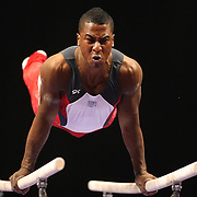 Joshua Dixon, U.S.O.T.C. in action on the Parallel bars during the Senior Men Competition at The 2013 P&G Gymnastics Championships, USA Gymnastics' National Championships at the XL, Centre, Hartford, Connecticut, USA. 16th August 2013. Photo Tim Clayton