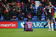 Wilfried Zaha of Crystal Palace sits on the pitch dejected after the final whistle. Barclays Premier League match, Crystal Palace v Chelsea at Selhurst Park in London on Sunday 3rd Jan 2016. pic by John Patrick Fletcher, Andrew Orchard sports photography.