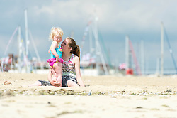 © Licensed to London News Pictures. 14/06/2014. Ryde, Isle of Wight, UK. Children play on the beach on a hot sunny morning.  Yachts can be seen in the background.  The UK is experiencing a period of hot sunny weather with temperatures over the weekend expected to reach 74 F (23 C).  Photo credit : Richard Isaac/LNP