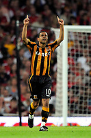 Fotball<br /> England<br /> Foto: Colorsport/Digitalsport<br /> NORWAY ONLY<br /> <br /> Deiberson Geovanni (Hull) points to the skies in celebration of the first Hull goal. Arsenal Vs Hull City. Barclays Premier League. Emirates Stadium. London. 27/09/2008