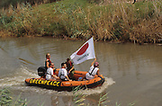 Greenpeace protest dinghy in a river in Israel