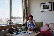 Aysen Dennis, a resident on the Aylesbury Estate for the past 24 years on 13th May 2016 in South London, United Kingdom. Originally from Turkey, Aysen came to London in 1988 and squatted in Camberwell, then moved to Brixton. 24 years ago, in 93 she moved into the Aylesbury Estate as a council tenant. For 16 years she has been fighting a class war against the regeneration of the estate, and is one of the founding members of the Fight for Aylesbury campaign.  The Aylesbury Estate, a large housing estate located in Walworth, it contains 2,704 dwellings and was built between 1963 and 1977. The estate is partially occupied and is currently undergoing a major redevelopment.