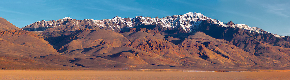 The east face of Steens Mountain, the largest fault-block mountain in the United States, presents a dramatic backdrop for the Alvord Desert below.