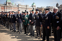 © Licensed to London News Pictures. 11/07/2013. London, UK. British veterans of the Korean War are seen on Horse Guards Parade in London today (11/07/2013) as they prepare to march to Westminster Abbey. The parade and service held to commemorate the 60th Anniversary of the end of the Korean War, often known as the 'Forgotten War', which saw a United Nations force of many nations fight against North Korean and Chinese forces trying to invade South Korea. Photo credit: Matt Cetti-Roberts/LNP
