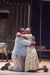"""© Licensed to London News Pictures. 10/07/2012.  London, England. Nonhlanhla Yende as Bess and Xolela Sixaba as Porgy. London Premiere of Cape Town Opera's fully-staged production of the Gershwin Opera """"Porgy and Bess"""" at the London Coliseum. A limited season of 14 performances from 11 to 21 July 2012. Directed by Christine Cross, Music/Lyrics by George Gershwin, DuBose and Dorothy Heyward and Ira Gershwin, accompanied by the Orchestra of Welsh National Opera. Photo credit: Bettina Strenske/LNP"""