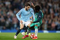 Football - 2018 / 2019 UEFA Champions League - Quarter-Final, Second Leg: Manchester City (0) vs. Tottenham Hotspur (1)<br /> <br /> Bernardo Silva of Manchester City is tackled by Danny Rose of Tottenham Hotspur, at The Etihad.<br /> <br /> COLORSPORT/PAUL GREENWOOD