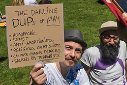June 10, 2017 - London, UK - London, UK. 10th June 2017. A man holds up a poster about the DUP at the rally in Parliament Square with speeches, music and dancing celebrating the remarkable performance against all the odds made by Labour led by Jeremy Corbyn in the General Election. They call for support for him inside and outside the Labour Party and for the fight for Labour values to continue and for all Labour MPs to get behind a leader who has shown he can grow the Labour vote. Speakers called for Theresa May to go, and expressed disgust at her making a pact with the far right DUP with its bigotry and close connection with paramilitary terrorism. Peter Marshall ImagesLive (Credit Image: © Peter Marshall/ImagesLive via ZUMA Wire)