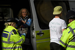 © Licensed to London News Pictures. 10/10/2019. London, UK. Police arrest Extinction Rebellion activists who refuse to move from the roads around Trafalgar Square in Westminster, central London where they have been demonstrating for a fourth day running. The climate change group have blockaded the Westminster area, demanding that the government takes immediate and decisive action on climate change. Photo credit: Ben Cawthra/LNP