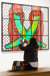 © Licensed to London News Pictures. 21/11/2017. London, UK. A visitor views artwork titled Crossed Beards by artists GEORGE PASSMORE and GILBERT PROUSCH otherwise known as GILBERT and GEORGE. The work is showing at the exhibition The Beard Pictures and Their Fuckosophy at the White Cube gallery. Photo credit: Ray Tang/LNP