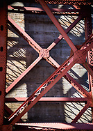 """Abstracted, detail view of the Golden Gate Bridge, as seen from Fort Point, San Francisco   Each 252-piece photo puzzle comes in a sturdy, finished cardboard box and measures 10"""" x 14"""" when complete"""