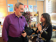 Lindenhurst, New York, USA. September 23, 2018.  L-R, magicians BOB YORBURG and wife LAURA YORBURG talk in theater lobby after Bob Yorburg, along with three other magicians, performed in Comedy Magic Show presented by The Parlor of Mystery and South Shore Theatre Experience. Bob Yorburg, AKA Professor Phineas Feelgood, is a master wood carver and used unusual props in show.