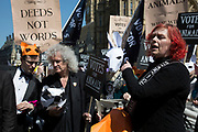 London, UK, 23rd April 2015. Campaigners speak as Brian May looks on at an animal welfare General Election drive. A day of action including a march on Parliament marks the launch of the 'Votes for Animals' campaign to highlight the importance of animal welfare issues in the General Election.  The aim of the campaign is to help inform the public on where their local candidates stand on the issue of animal welfare and to take this into consideration when voting. The initiative is spearheaded by ethical cosmetic company Lush, and backed by animal protection organisations League Against Cruel Sports, Animal Aid and Brian May's Common Decency organization.