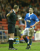Photo. Andrew Unwin.<br /> Sunderland v Birmingham City, FA Cup Fifth Round, Stadium of Light, Sunderland 14/02/2004.<br /> Birmingham's Damien Johnson (r) is booked by the referee, Mr G Barber (l).