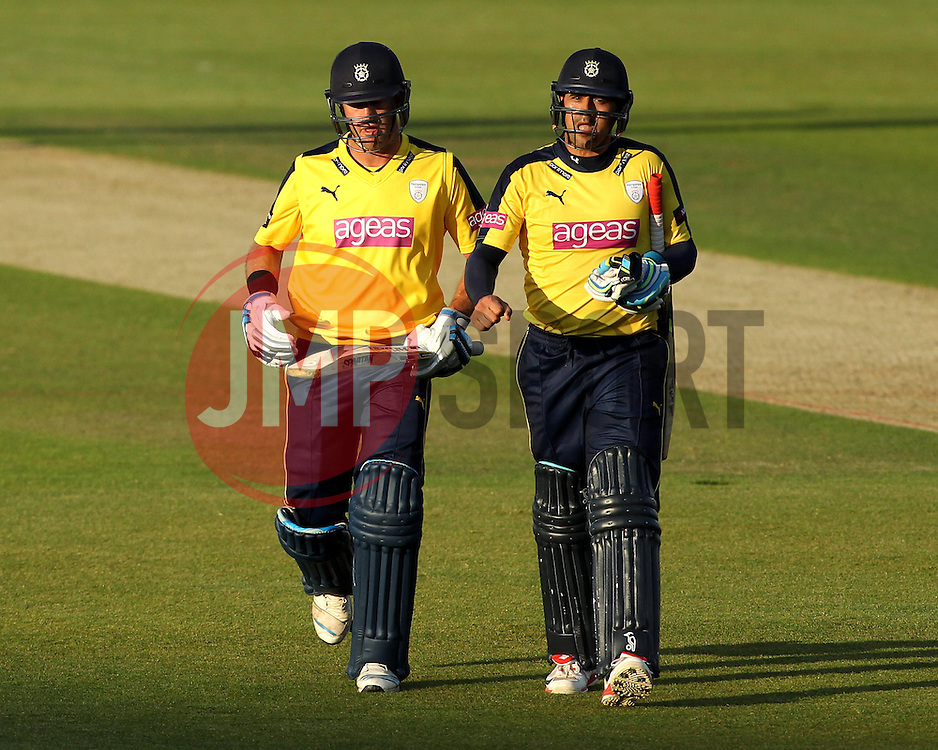 Hampshire's Sean Ervine and Hampshire's Owais Shah walk off at the end of the Hampshire innings - Photo mandatory by-line: Robbie Stephenson/JMP - Mobile: 07966 386802 - 04/06/2015 - SPORT - Cricket - Southampton - The Ageas Bowl - Hampshire v Middlesex - Natwest T20 Blast