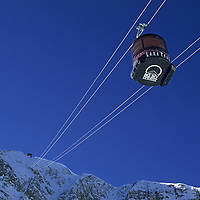 SKIING, Big Sky, Montana. Lone Peak Tram ascends Lone Mountain, giving the resort record-breaking vertical footage.
